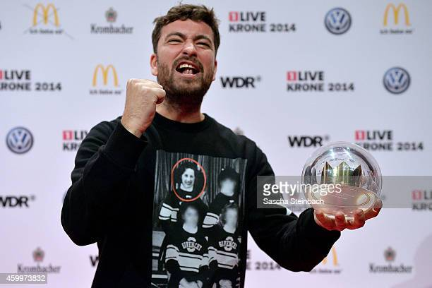 'Materia' poses with the award during the 1Live Krone 2014 at Jahrhunderthalle on December 4 2014 in Bochum Germany