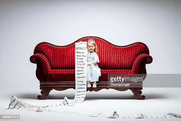 material girl -princess wish list humor child sofa consumerism - long hair stock pictures, royalty-free photos & images