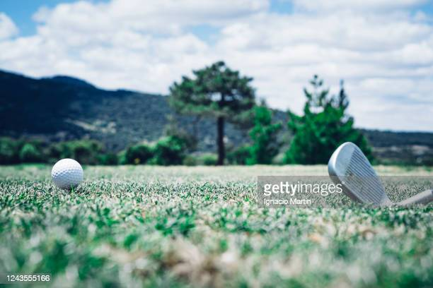material to practice the sport of golf on a luxury course. the image consists of a wedge and a white golf ball. - eagle golf stock pictures, royalty-free photos & images