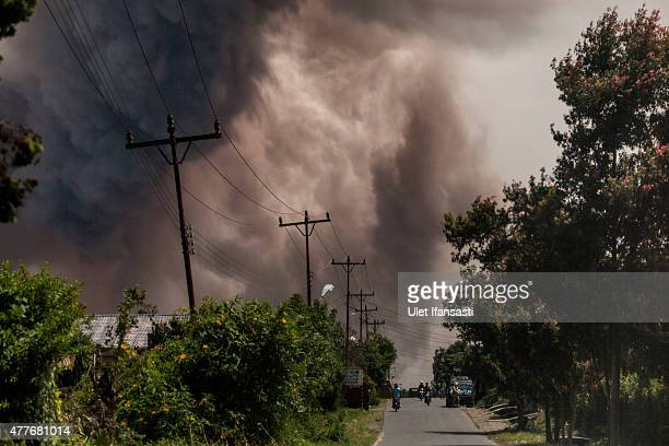 Material vulcanic is seen into the sky as Mount Sinabung spews pyroclastic smoke seen from Simpang Empat village on June 19 2015 in Karo District...