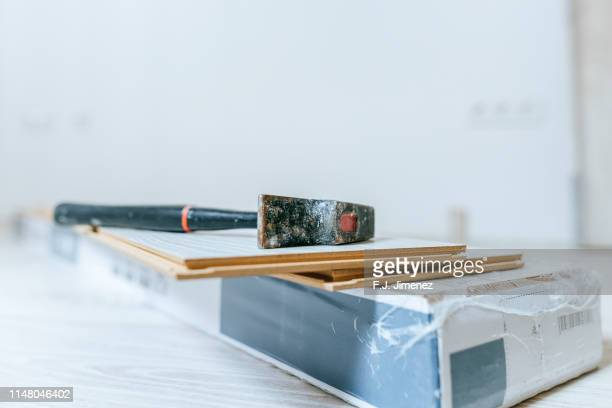 materials for laying wooden laminate flooring - installing stock pictures, royalty-free photos & images