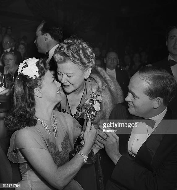 Maternal pride shine in the face of Mrs Lela Rogers as daughter Ginger Rogers shows her the Oscar she received for her title role portrayal in the...