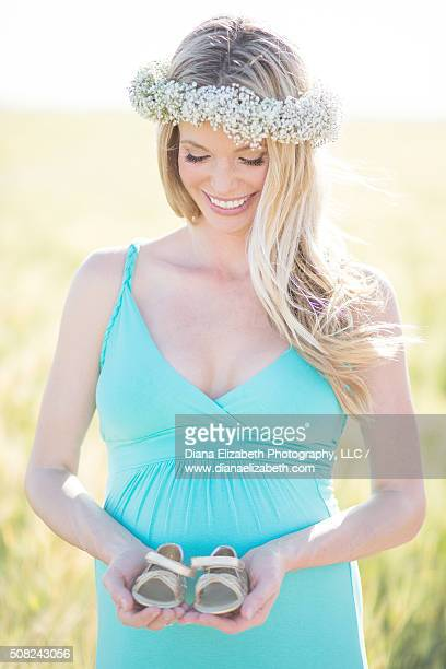Maternity Pregnant Blonde in tall Barley Wheat Field