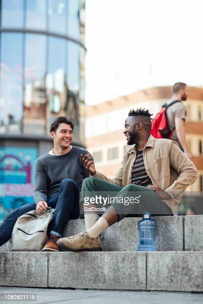 mates in the city - sitting stock pictures, royalty-free photos & images