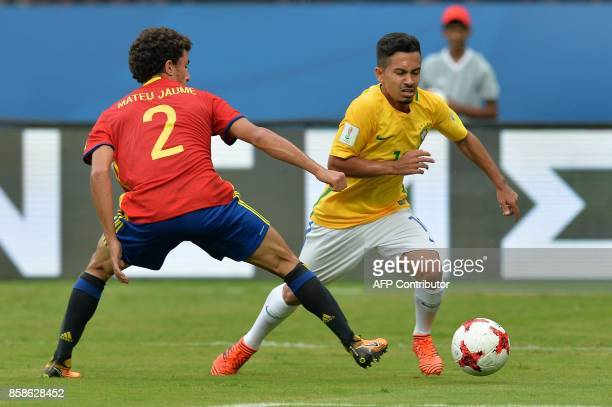 Mateu Jaume of Spain and Alan of Brazil compete for the ball during their group stage football match in the FIFA U17 World Cup played at the...