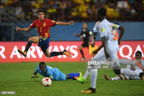 Mateu Jaume of Spain jumps over Khaled Lawali of Niger during the FIFA U17 World Cup India 2017 group D match between Spain and Niger at the...