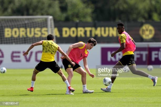 Mateu Morey challenges Leonardo Balerdi during a Borussia Dortmund training session at Training Ground Brackel on July 05 2019 in Dortmund Germany...