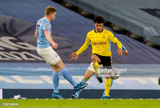 Mateu Morey of Borussia Dortmund in action with Kevin De Bruyne of Manchester City during the Champions League match between Manchester City and...