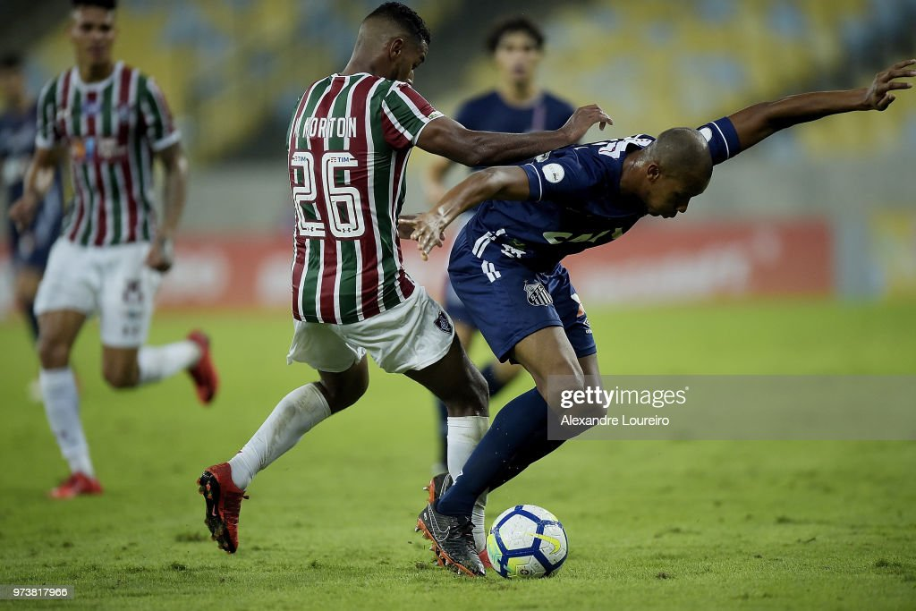 Mateus (L) of Fluminense struggles for the ball with Copete of Santos during the match between Fluminense and Santos as part of Brasileirao Series A 2018 at Maracana Stadium on June 13, 2018 in Rio de Janeiro, Brazil.