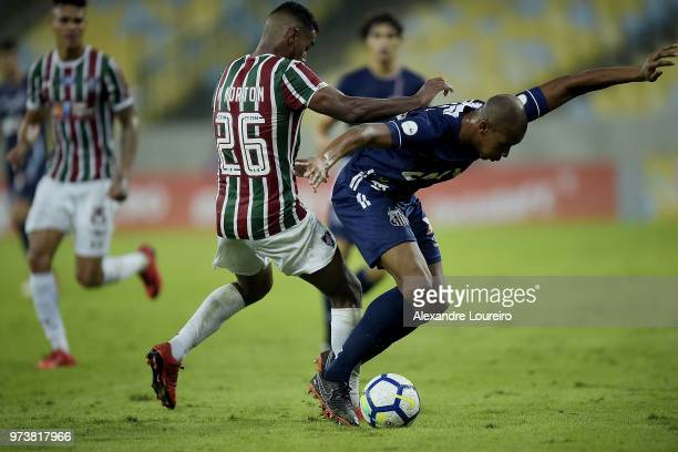 Mateus of Fluminense struggles for the ball with Copete of Santos during the match between Fluminense and Santos as part of Brasileirao Series A 2018...