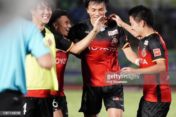 Mateus of Nagoya Grampus celebrates scores his side's first on goal with team mates during the J.League Meiji Yasuda J1 match between Shonan Bellmare...