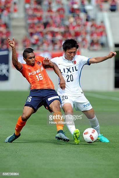Mateus of Omiya Ardija and Kento Misao of Kashima Antlers compete for the ball during the J.League Yamazaki Nabisco Cup match between Omiya Ardija...