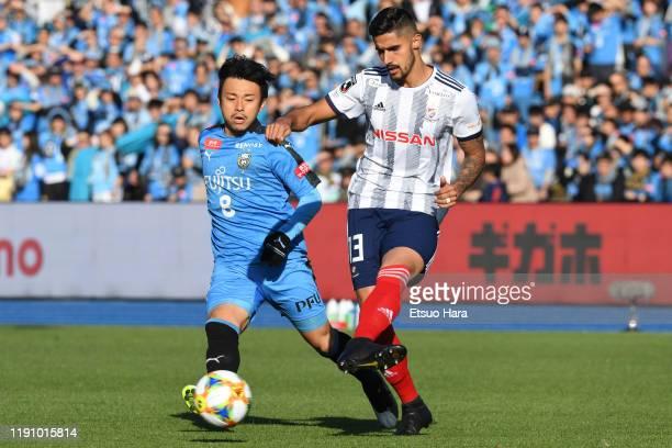 Mateus of Yokohama FMarinos and Hiroyuki Abe of Kawasaki Frontale compete for the ball during the JLeague J1 match between Kawasaki Frontale and...