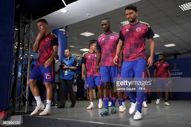 Mateus Uribe Carlos Bacca Cristian Zapata and Abel Aguilar of Colombia walk out for the warm up prior to the 2018 FIFA World Cup Russia group H match...