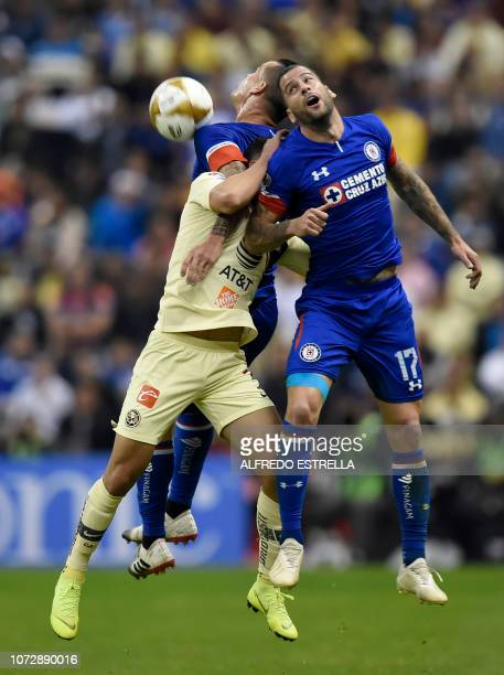 Mateus Uribe of America vies for the ball with Milton Caraglio and Martin Cauteruccio of Cruz Azul during the first round match of the final of the...
