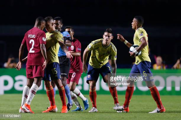 Mateus Uribe of Colombia and RóRó of Qatar argue during the Copa America Brazil 2019 group B match between Colombia and Qatar at Morumbi Stadium on...