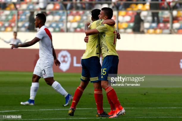 Mateus Uribe of Colombia celebrates with teammate after scoring the first goal of his team during a friendly match between Peru and Colombia at...