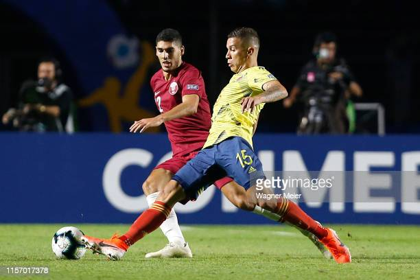 Mateus Uribe of Colombia fights for the ball with Karim Boudiaf of Qatar during the Copa America Brazil 2019 group B match between Colombia and Qatar...