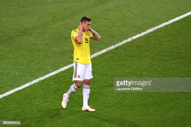 Mateus Uribe of Colombia looks dejected after he misses his team's fourth penalty in the penalty shoot out during the 2018 FIFA World Cup Russia...
