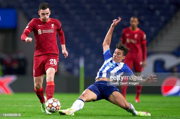 Mateus Uribe of FC Porto competes for the ball with Andrew Robertson of Liverpool FC during the UEFA Champions League group B match between FC Porto...
