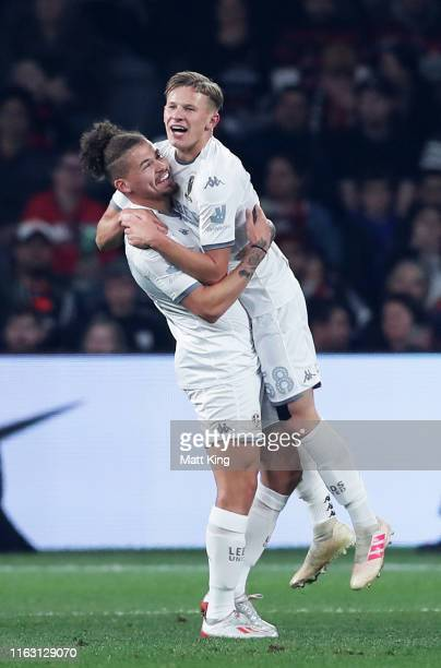 Mateusz Bogusz of Leeds United celebrates with Kalvin Phillips after scoring a goal during the match between the Western Sydney Wanderers and Leeds...
