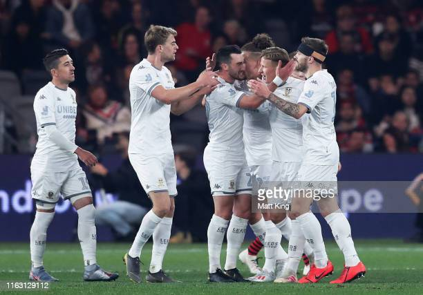 Mateusz Bogusz of Leeds United celebrates with team mates after scoring a goal during the match between the Western Sydney Wanderers and Leeds United...