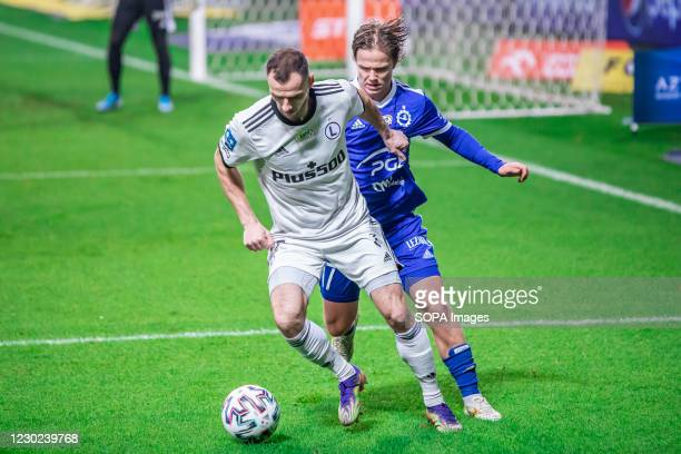Mateusz Cholewiak of Legia and Petteri Forsell of Stal are seen in action during the Polish PKO Ekstraklasa League match between Legia Warszawa and...