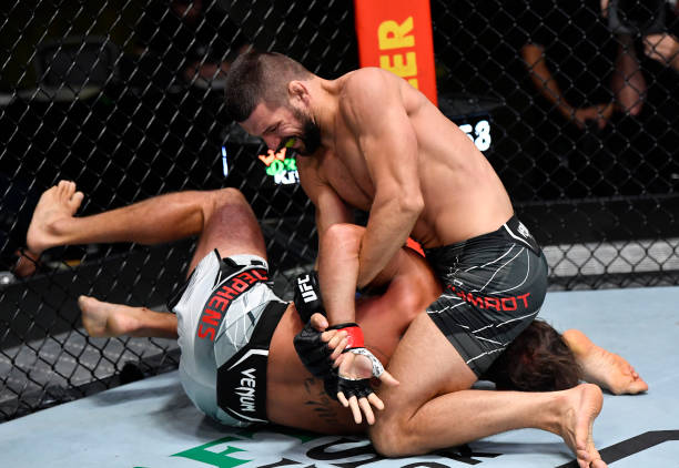 Mateusz Gamrot of Poland secures a submission against Jeremy Stephens in their middleweight bout during the UFC Fight Night event at UFC APEX on July...