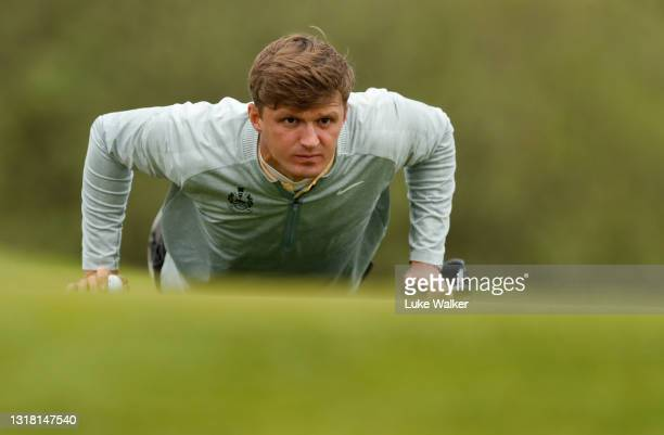 Mateusz Gradecki of Poland lines up a putt on the 16th hole during Day Three of the Range Servant Challenge by Hinton Golf at Hinton Golf Club on May...