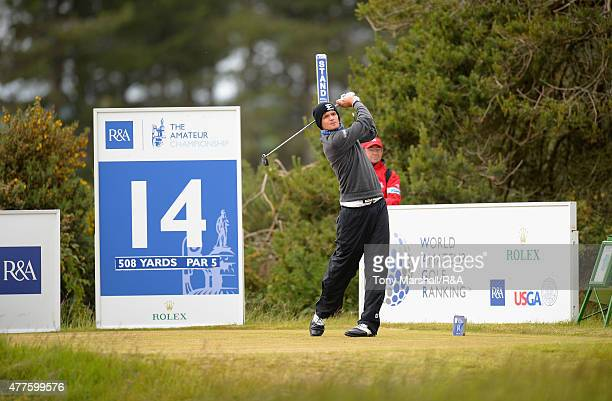 Mateusz Gradecki of Poland plays shot his first on the 14th tee during The Amateur Championship 2015 Day Four at Carnoustie Golf Club on June 18 2015...
