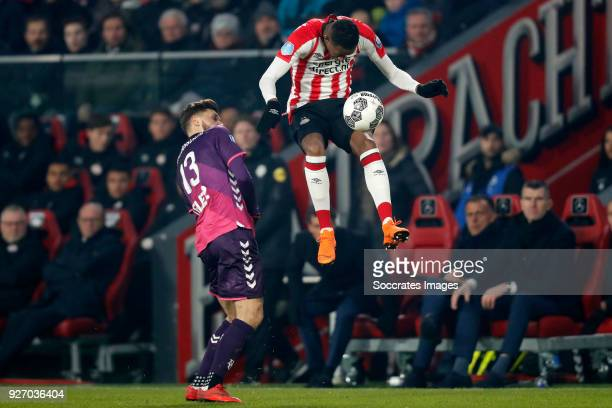 Mateusz Klich of FC Utrecht Joshua Brenet of PSV during the Dutch Eredivisie match between PSV v FC Utrecht at the Philips Stadium on March 3 2018 in...