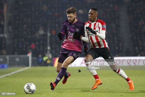 Mateusz Klich of FC Utrecht Joshua Brenet of PSV during the Dutch Eredivisie match between PSV Eindhoven and FC Utrecht at the Phillips stadium on...