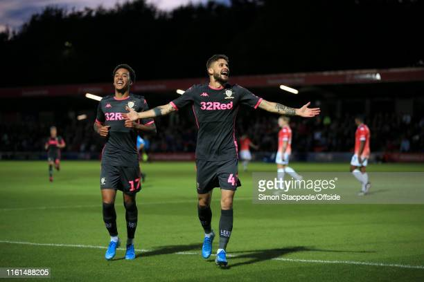 Mateusz Klich of Leeds celebrates with teammate Helder Costa of Leeds after scoring their 3rd goal during the Carabao Cup First Round match between...