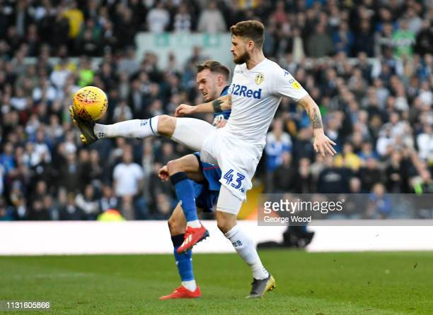 Mateusz Klich of Leeds United and Craig Noone of Bolton Wanderers compete for the ball during the Sky Bet Championship match between Leeds United and...