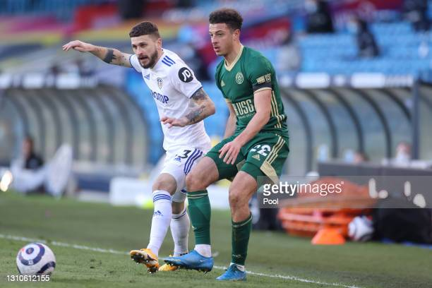 Mateusz Klich of Leeds United battles for possession with Ethan Ampadu of Sheffield United during the Premier League match between Leeds United and...