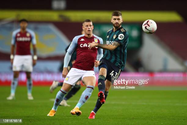 Mateusz Klich of Leeds United battles for possession with Ross Barkley of Aston Villa during the Premier League match between Aston Villa and Leeds...