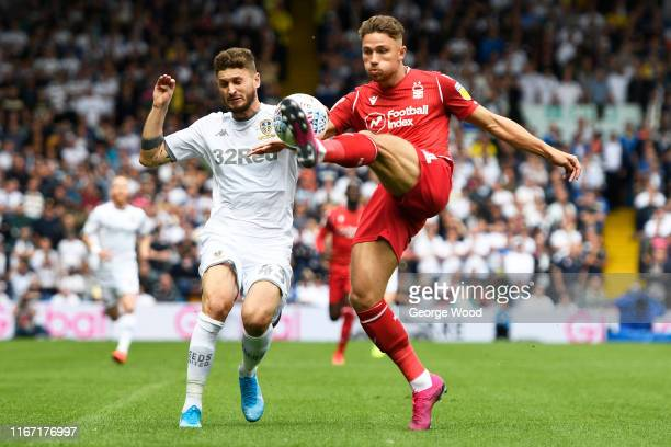 Mateusz Klich of Leeds United battles for the ball with Matthew Cash of Nottingham Forest during the Sky Bet Championship match between Leeds United...