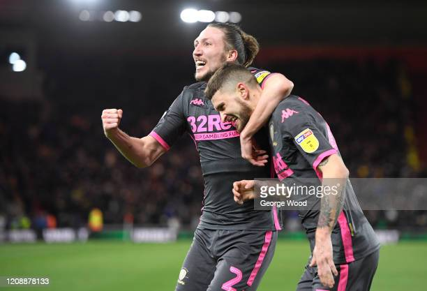 Mateusz Klich of Leeds United celebrates with Luke Ayling after scoring his team's first goal during the Sky Bet Championship match between...