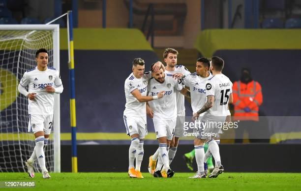 Mateusz Klich of Leeds United celebrates with team mates Ezgjan Alioski, Patrick Bamford, Raphinha and Stuart Dallas after scoring their sides first...
