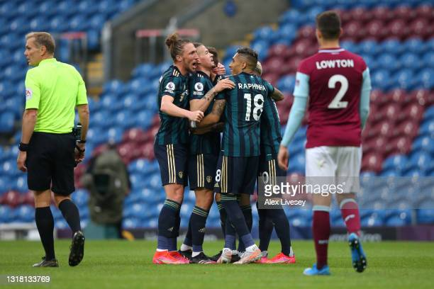 Mateusz Klich of Leeds United celebrates with team mates Luke Ayling, Kalvin Phillips and Raphinha after scoring their side's first goal during the...