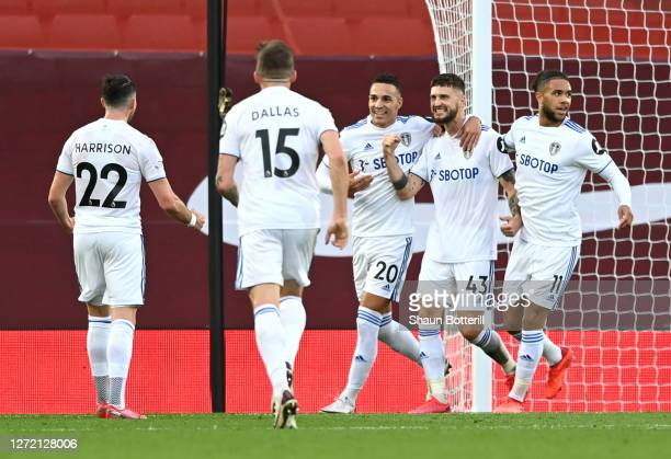 Mateusz Klich of Leeds United celebrates with teammates after scoring his team's third goal during the Premier League match between Liverpool and...
