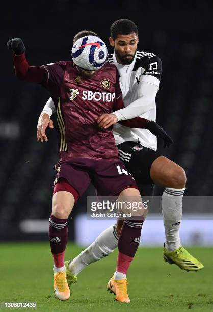Mateusz Klich of Leeds United holds off Ruben Loftus-Cheek of Fulham during the Premier League match between Fulham and Leeds United at Craven...
