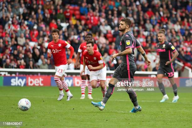 Mateusz Klich of Leeds United scores a goal from the penalty spot to make it 0-2 during the Sky Bet Championship match between Barnsley and Leeds...