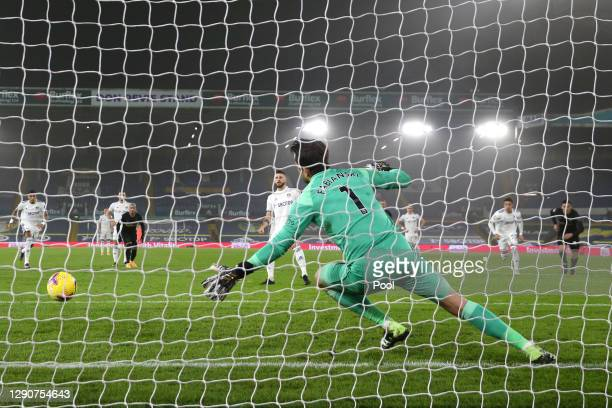 Mateusz Klich of Leeds United scores their sides first goal from the penalty spot past Lukasz Fabianski of West Ham United after VAR awarded a retake...