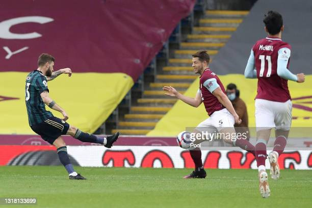 Mateusz Klich of Leeds United scores their side's first goal whilst under pressure from James Tarkowski of Burnley during the Premier League match...