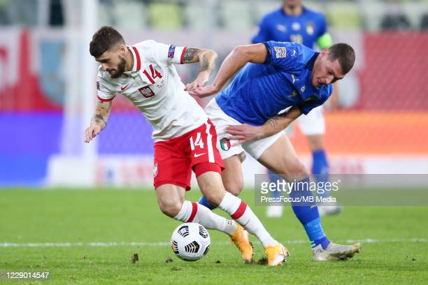 Mateusz Klich of Poland and Andrea Belotti of Italy compete for the ball during the UEFA Nations League group stage match between Poland and Italy at...