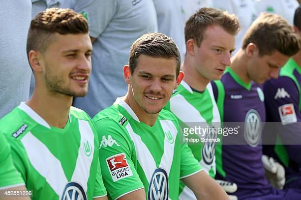 Mateusz Klich Sebastian Jung and Maximilian Arnold line up prior to the VfL Wolfsburg team presentation on July 23 2014 in Bad Ragaz Switzerland
