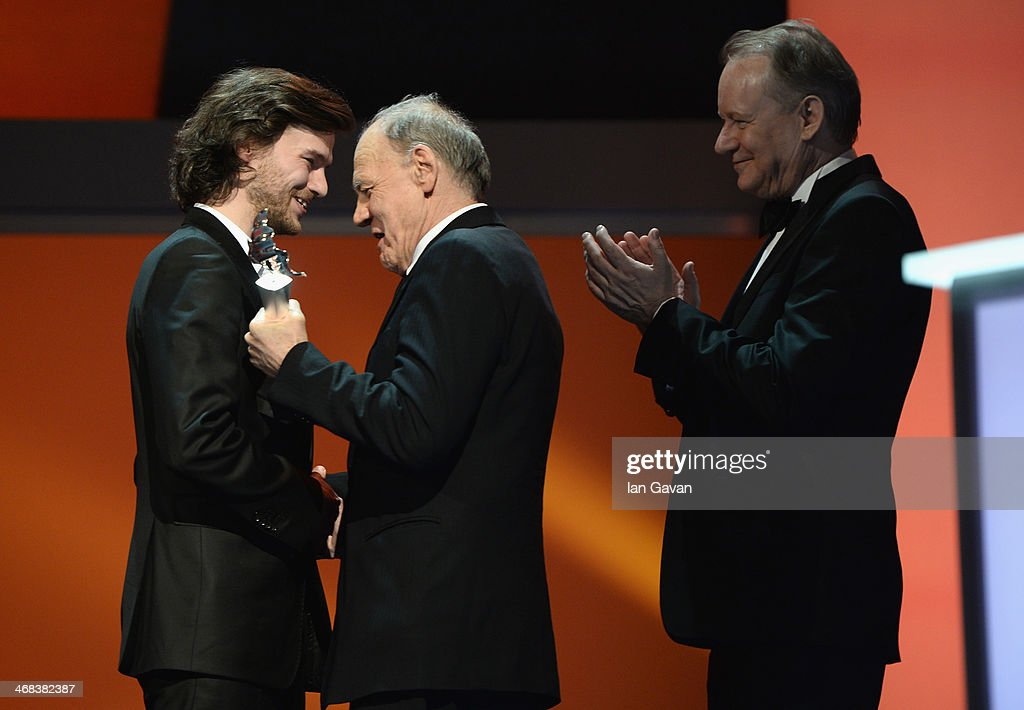 Mateusz Kosciukiewicz, Bruno Ganz and Stellan Skarsgard on stage at the Shooting Stars stage presentation during the 64th Berlinale International Film Festival at the Berlinale Palast on February 10, 2014 in Berlin, Germany.