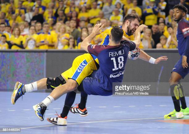Mateusz Kus Nedim Remili during the EHF Men's Champions League Game between PGE Vive Kielce and PSG Handball on November 26 2017 in Kielce Poland