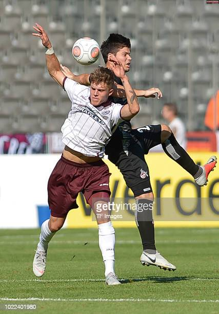 Mateusz Lewandowski of BFC Dynamo and Jorge Mere of FC Koeln battle for the ball during the DFB Cup first round match between BFC Dynamo and 1 FC...